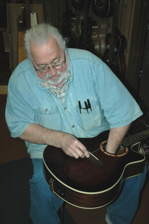 Marv Working On Guitar